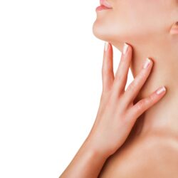 Closeup of a young woman regards her neck isolated on white background
